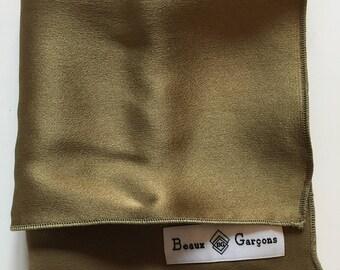 Gold colored suit jacket pocket
