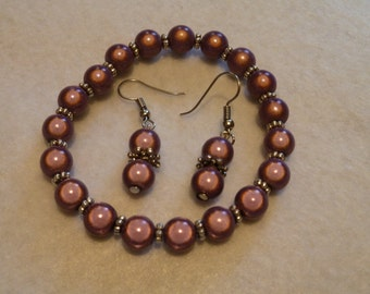 Set earring + bracelet with miracle beads in plum