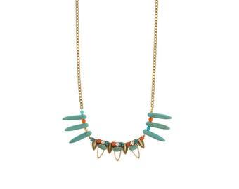 Finish aged turquoise beaded gold necklace.