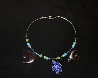 Here Fishy, fishy bangle charm bracelet
