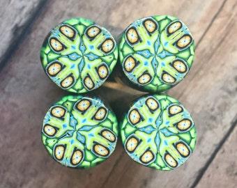 Polymer clay cane, green, orange, blue
