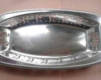 E. p. n. S silver plated dish. B. h. L d E.P.N.S. decorated with grapes and vine leaves.