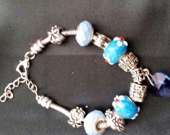 sterling silver chain bracelet with blue beads and silver charms