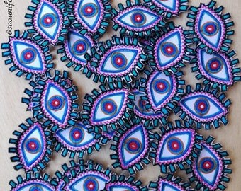 Applique embroidered patches blue pink eye size of preference are manufacturers