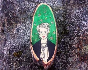 Hand illustrated Frida Kahlo on wood slice