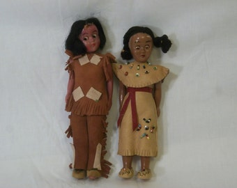 Pair of Native American dressed 7 inch dolls Moving arms and heads suede clothing sleeping eyes Reliable