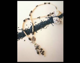 Long necklace with decorative clasp and big Crystal pendant