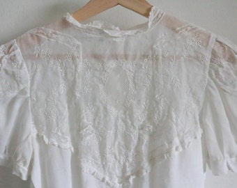 White victorian style blouse with lace and embroidery