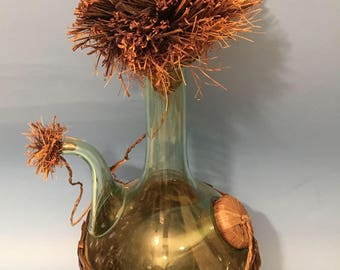 Vintage Wine Bottle Decanter Italian Hand Blown Green Glass. With Ice Chamber And Handcrafted With Wicker Bottom And Wicker Stoppers.