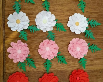 3 D Daisy styled die cut flowers. Scrapbook or cardmaking