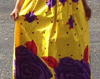 African print maxi skirt. Yellow with purple and red prints.