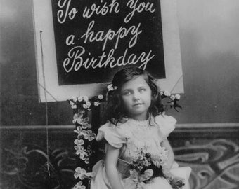 Vintage postcard of a young girl holding some flowers ~ To wish you a happy Birthday
