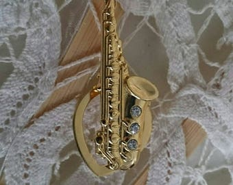 Gold saxophones - vintage dress clips with Rhinestones occupied, gold, music, jewelry, jewels, clip