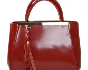 Luxurious red leather handbag
