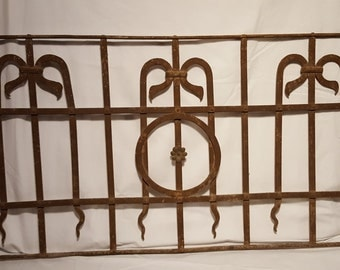 Antique wrought iron fence piece