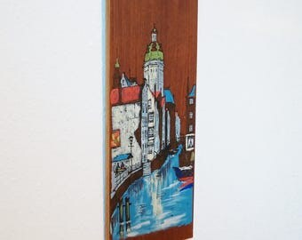 Painting oil screen printing mixed media on teak wood. 50s and 60s residential decor. City: Amsterdam. Canal. View of St. Nikolaus. Mid century art.