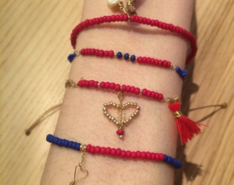 Filigree bracelet with red beads beads and golden heart red Pompom