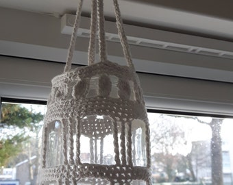 Hanging glass lantern with crochet cover