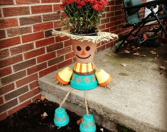 Scarecrow flower pot