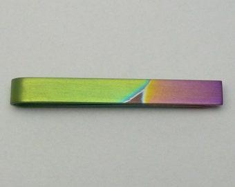 Anodized titanium tie clip.