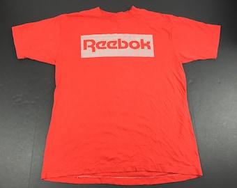 Vintage 80s Reebok logo spellout t-shirt mens L