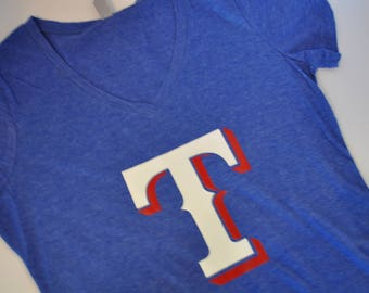 You know what the T stands for:  Texas Rangers Shirt