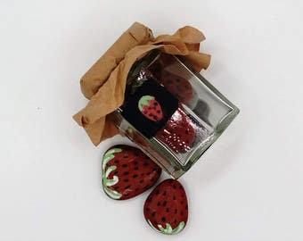 strawberry fridge magnets in a jar