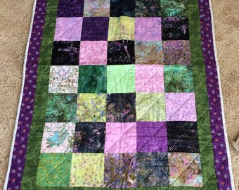 Lap quilt /  topper /  hand quilted  /  Batik fabric/  purples and greens /  dove grey binding and backing