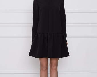 Charming black dress with ruffle skirt, collar and plead