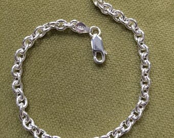 Sterling Silver ladies bracelet, looks great as is - or add your favorite charms(: