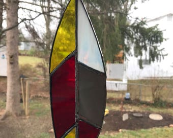 Red yellow and gray stained glass feathers