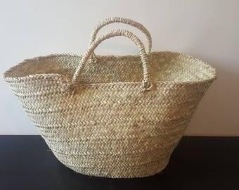 Berber basket in natural leaves. Ethnic Berber decoration.