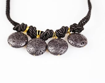Volcano with lace collar. Necklace of stone and bronze. Black necklace