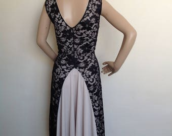 Argentine Tango dress, in small size in black lace with cream lining and godet