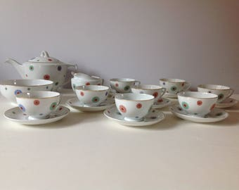 Vintage retro tea service. Unusual pattern. Tea pot, milk jug, sugar bowl, cups and saucers.