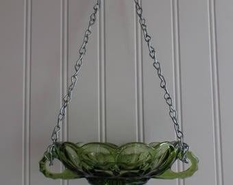 green glass bird feeder