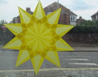Yellow star shaped kite paper window star