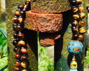 Tiger Eye mala with 108 semi precius gemstones made with a lot of love.
