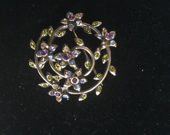 Monet Rhinestone Flower and Vine Brooch Pin Signed Goldtone Blue Purple Green