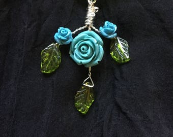 Pretty Blue Roses Wire Wrapped With Glass Leaves on a Green Ribbon