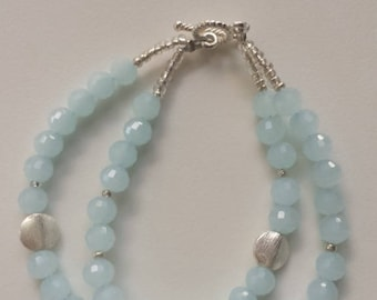Beautiful handcrafted blue crystal bracelet with brushed silver beads.