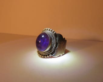 Vintage wide band ring with purple stone