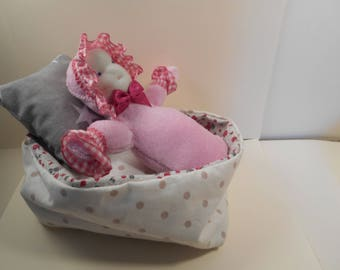 the adorable Waldorf baby in her reversible basket