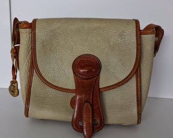 Vintage Dooney and Bourke leather cream and tan crossbody bag