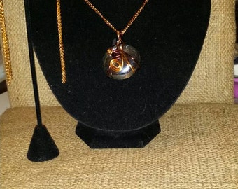 Artisan wire wrapped glass pendant with dangle gold tone earrings