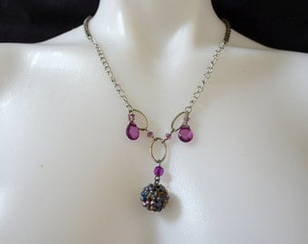purple and silver assemblage necklace