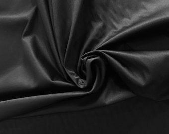 Deep black stretch cotton sateen fabric 97% cotton 3 lycra blend bottom weight glowy sheen matte shine onyx