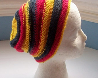 Unisex beanie hat, wool rich yarn, hand knitted, classic beehive design, striking contemporary colours  - red, yellow, black