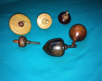 Five handmade wooden tops made by me.