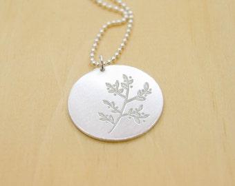 Delicate botanical pendant